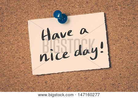 Have a nice day note pin on the bulletin board