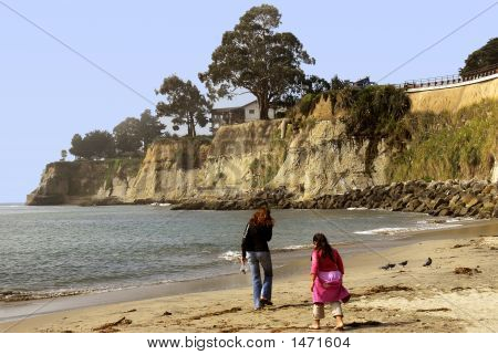Mother And Daughter Beachcombing