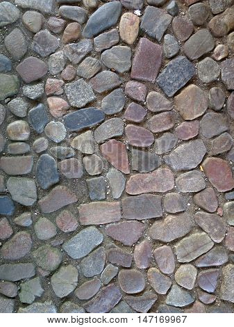Irregular cobblestoned yard at castle in Southern Denmark