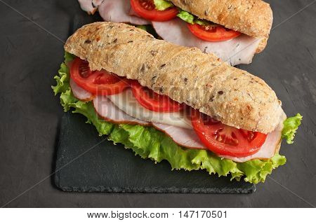Sandwich With Ham And Tomatoes