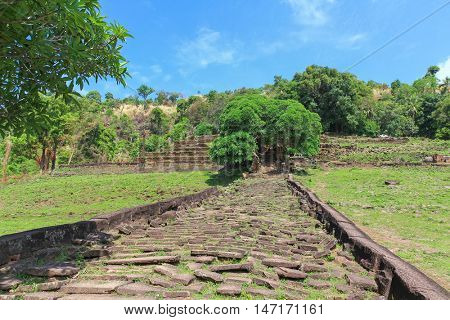 Stoney walkway and staircase leading to upper level of rained Vat Phou (Wat Phu)  Khmer Hindu temple complex and UNESCO World Heritage Site in Champasak Province, southern Laos
