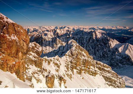 Beautiful View From Highest Mountain Peak Zugspitze Near Garmisch Partenkirchen. Cold Winter Day Wit