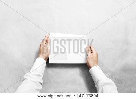 White blank envelope mockup hold in hands. Empty letter with transparent window design mock up. Message template presentation. Person open clear mail.