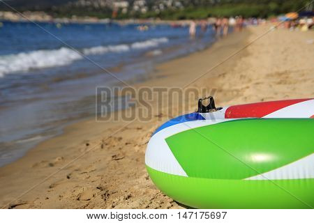 Colorful Inflatable Ring On A Beautiful Sandy Beach In The Summer Sunshine