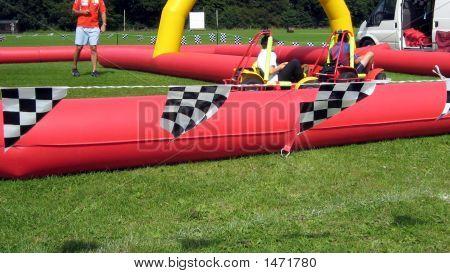 Children Playing On Gocarts