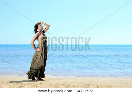 Beautiful African-American model by the sea