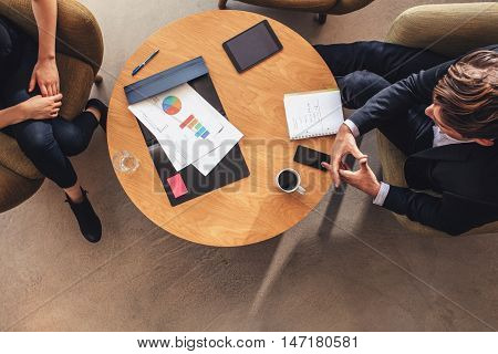 Business Colleague Sitting At Table During Corporate Meeting