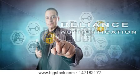 Corporate information security manager with confident face is activating the phrase RELIANCE AUTHENTICATION onscreen. Information technology concept for a multi-factor identity allocation process.