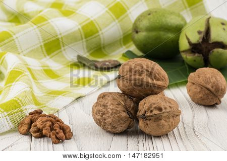 Walnut closeup on an old white wooden table. Selective focus.