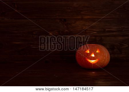 Jack O Lanterns Halloween Pumpkin On Wooden Background