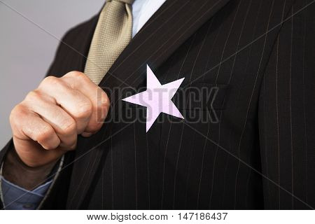 Extreme closeup of a businessman with gold star on suit