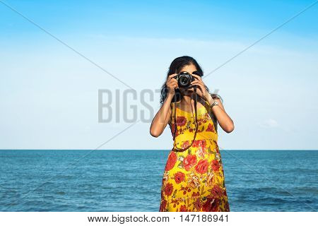 portait beautiful women take camera at the sea