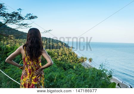 beautiful women looking the sea at viewpoint