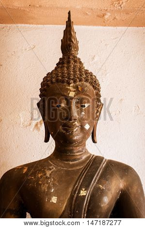 close up of old buddha statue Thailand