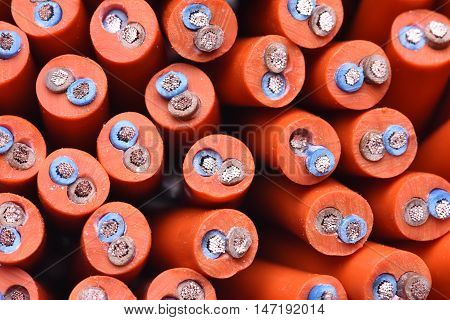 Electric cables closeup, orange power supply cord