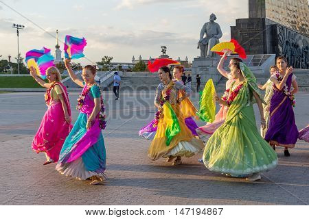 Moscow Russia - September 02 2016: Street Harinam Kirtan - the practice of chanting the holy names of God. Women in saris and with fans.