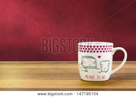 Background with heart coffee mug on wood table - Concepts eternal love