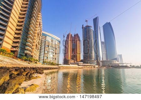 ABU DHABI, UAE - MARCH 28, 2014: Sunrise at Etihad Towers in Abu Dhabi, UAE. Five towers complex with 74 floors is the third tallest building in Abu Dhabi.