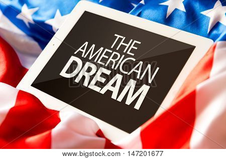 The American Dream on tablet and the US flag