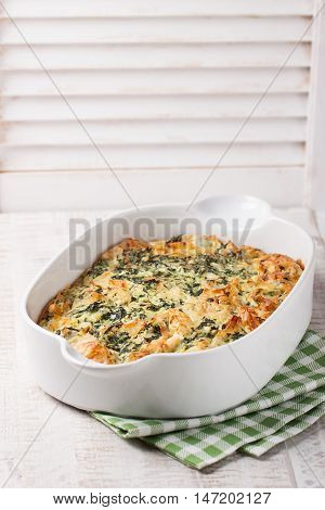 Homemade pie with spinach cheese and filo pastry closeup