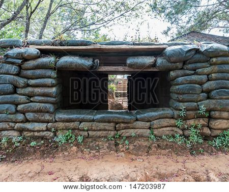 Cement shelter with sandbag of the old military base on the high mountain.