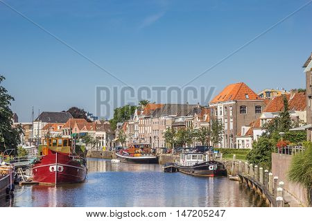 ZWOLLE, NETHERLANDS - AUGUST 31, 2016: Canal with old ships and historical houses in Zwolle, The Netherlands