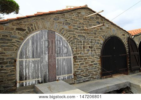 Rustic old provencal boat house with wooden doors