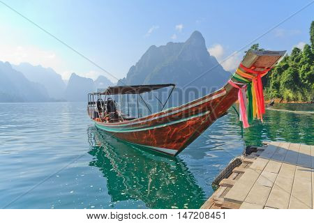 Long tail boat against mountain and lake. Chiao Lan damSurat Thani Thailand.