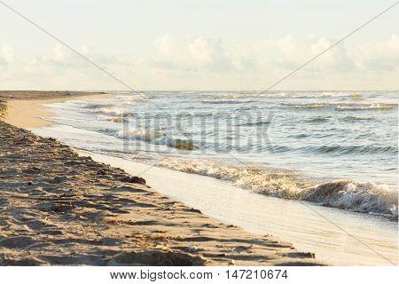 Landscape sea sunrice golden sky and wave on sand beach