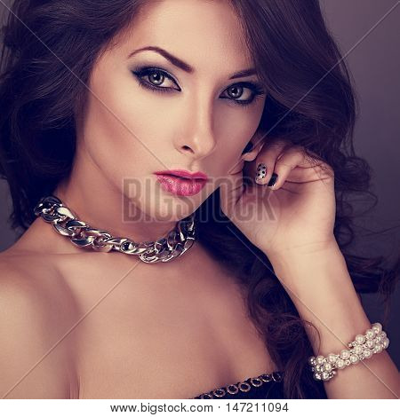 Beautiful Evening Makeup Woman With Long Curly Hairstyle Looking Sexy In Pearl Bangle And Fashion Ne