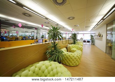 MOSCOW - JUN 03, 2015: Couches in rest zone of office. Tinkoff Credit Systems is first Russian bank that has completely refused from branch of bank