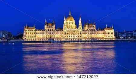 Budapest Parliament At Blue Hour Near The Danube River