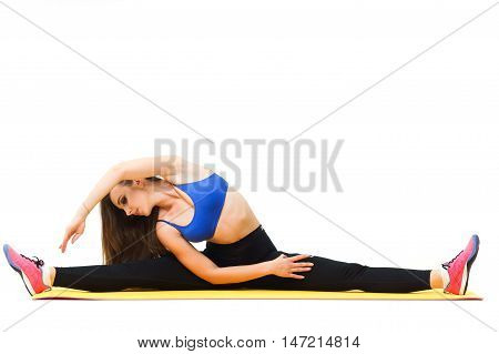Beautiful Trainer Working Out With Yoga Mat Isolated On White
