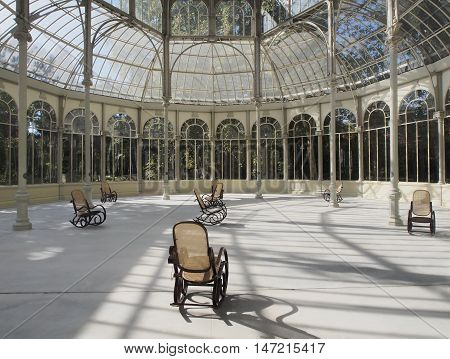 Crystal Palace is a glass and metal structure in rocking chairs you can relax and read a book