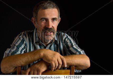 Portrait of smiling Ukrainian peasant in low key