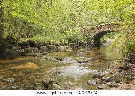 An image of Hisley Bridge, Devon, England, UK on a warm sunny day.
