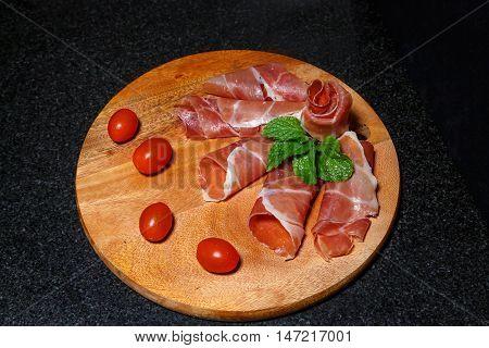 Food wooden cutting board with ham. Ham