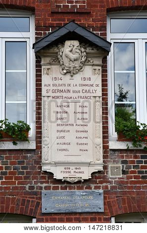 Saint Germain sous Cailly France - june 23 2016 : the war memorial on the city hall