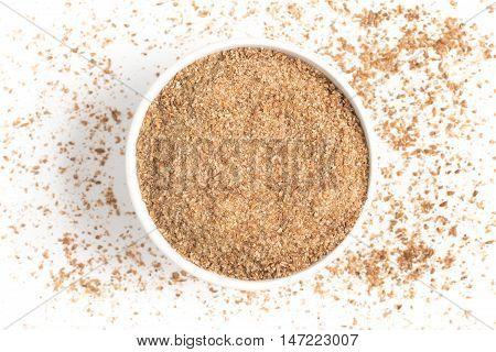 Ground Wheat into a bowl isolated in white background. Trigo para quibe. Kibbeh