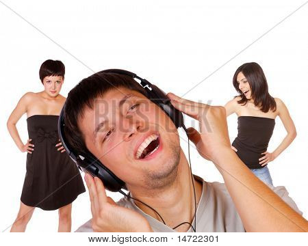 Man is listening to the music with two girls dancing on  background