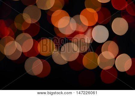 defocused colored lights on the black background