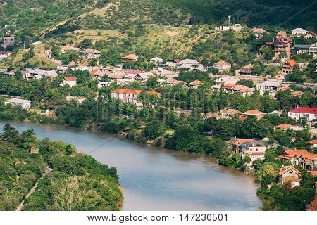 The Scenic Top View Of Mtskheta, Georgia. The Residential Area Along Bank Of The Aragvi River In Summer Sunny Day.