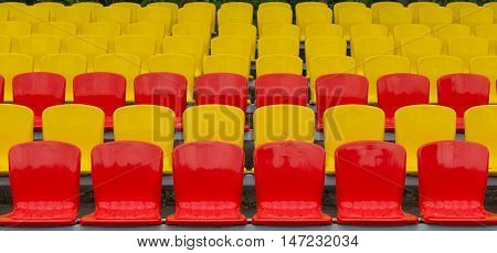 yellow red grandstand at the football stadium