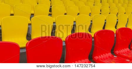 yellow red grandstand at the footbol stadium