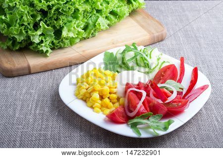 Useful Natural Salad On A Gray Tablecloth