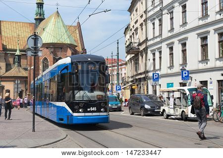 POLAND, KRAKOW - MAY 27, 2016: Tram Bombardier NGT6 in the historic part of Krakow. Total in Krakow more than 90 kilometers of tram tracks and 24 routes.