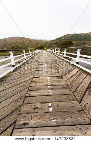 Wooden structure Penmaenpool toll bridge over the River Mawddach near Dolgellau Wales United Kingdom