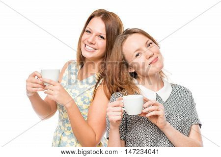 Horizontal Portrait Of Two Women With Cups Of Coffee On A White Background