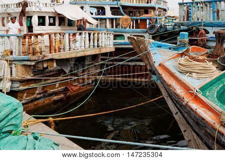 DUBAI, UNITED ARAB EMIRATES (UAE), 4 April 2016. Editorial Photograph of Dhows moored at Wharfage on Dubai Creek (Khor Dubai), Deira.  The dhows ply the Indian Ocean and the Gulf, trading with India, Pakistan and East Africa, amongst other places.