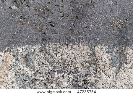 Rough gray surface of the stone to be used as wallpaper.